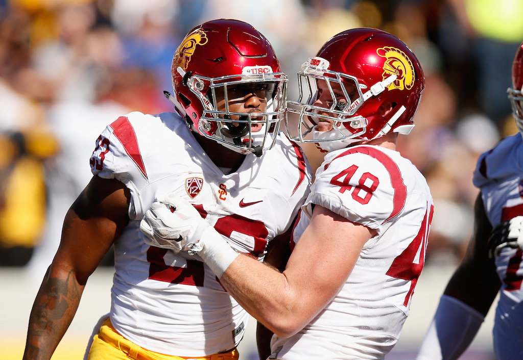 Ezra Shaw/Getty Images Tre Madden #23 of the USC Trojans is congratulated by Taylor McNamara #48