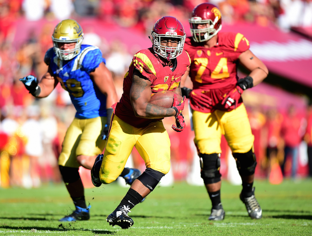 Tre Madden #23 of the USC Trojans runs for a first down