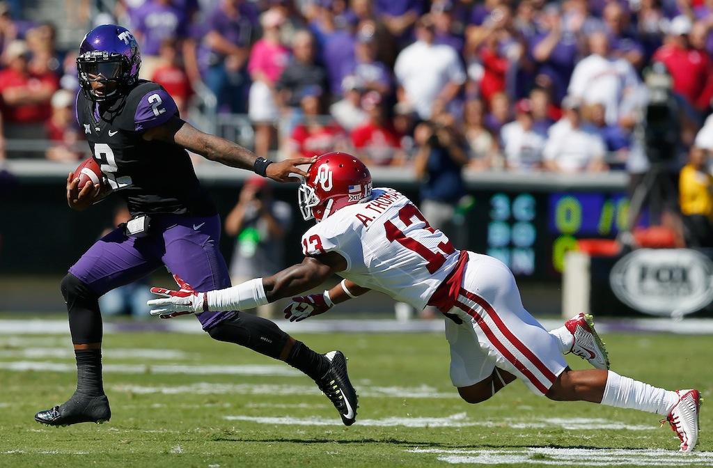 Trevone Boykin tries to elude Oklahoma defender