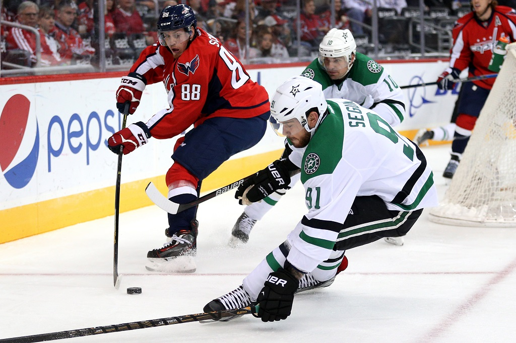 WASHINGTON, DC - NOVEMBER 19: Nate Schmidt #88 of the Washington Capitals skates with the puck as he is defended by Tyler Seguin #91 and Patrick Sharp #10 of the Dallas Stars in the first period at Verizon Center on November 19, 2015 in Washington, DC.