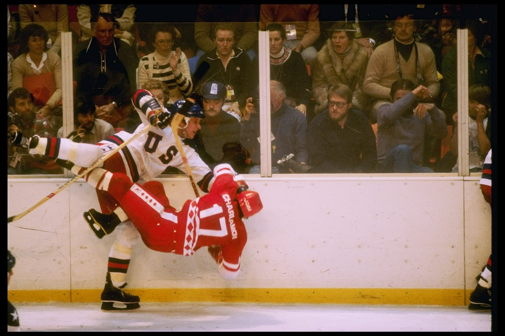 LAKE PLACID, NY - FEBRUARY 22: Mike Ramsey #5 of the United States checks Valeri Kharlamov #17 of the Soviet Union during the Winter Olympic Games on February 22, 1980 in Lake Placid, New York. The United States won 4-3.