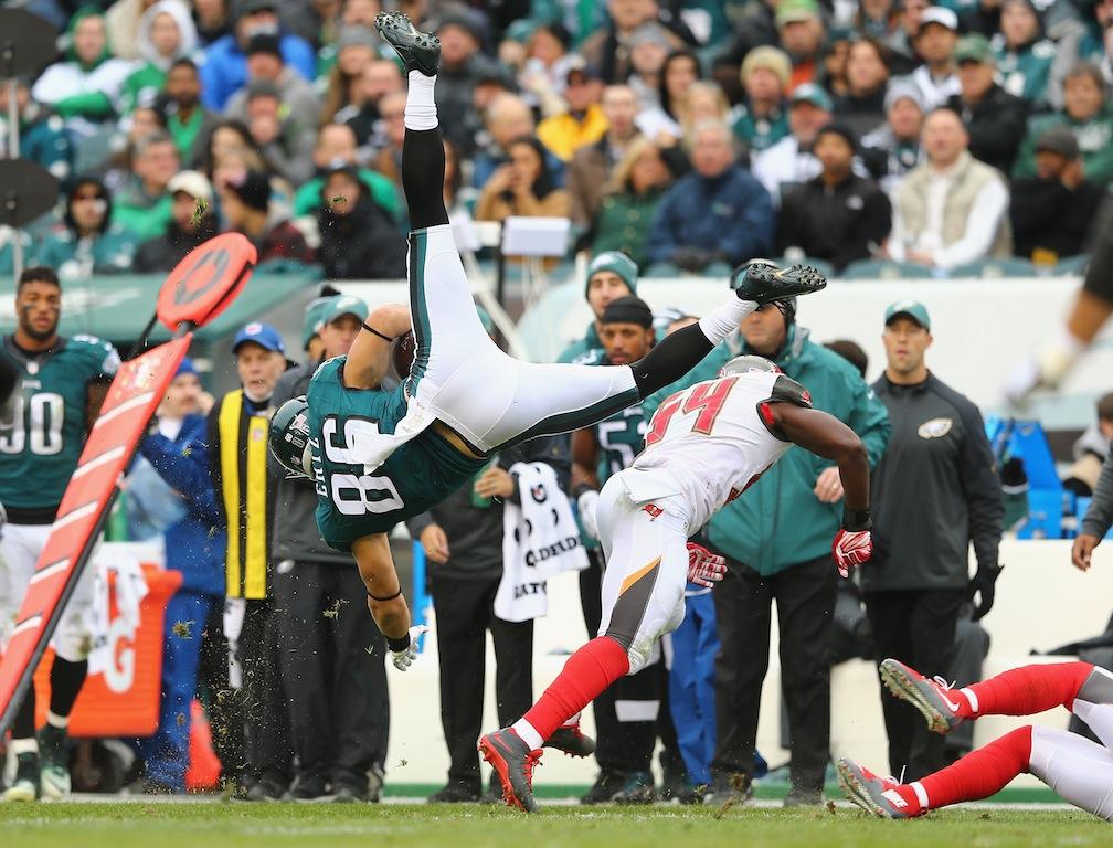 Zach Ertz #86 flies through the air after making a reception