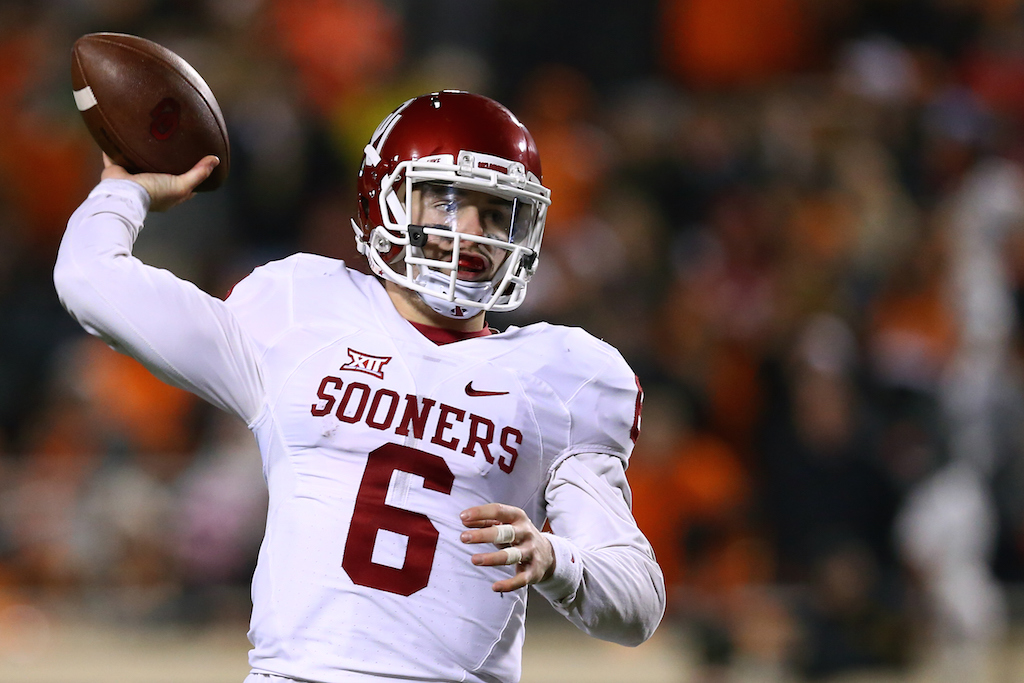 Baker Mayfield throws against Oklahoma State