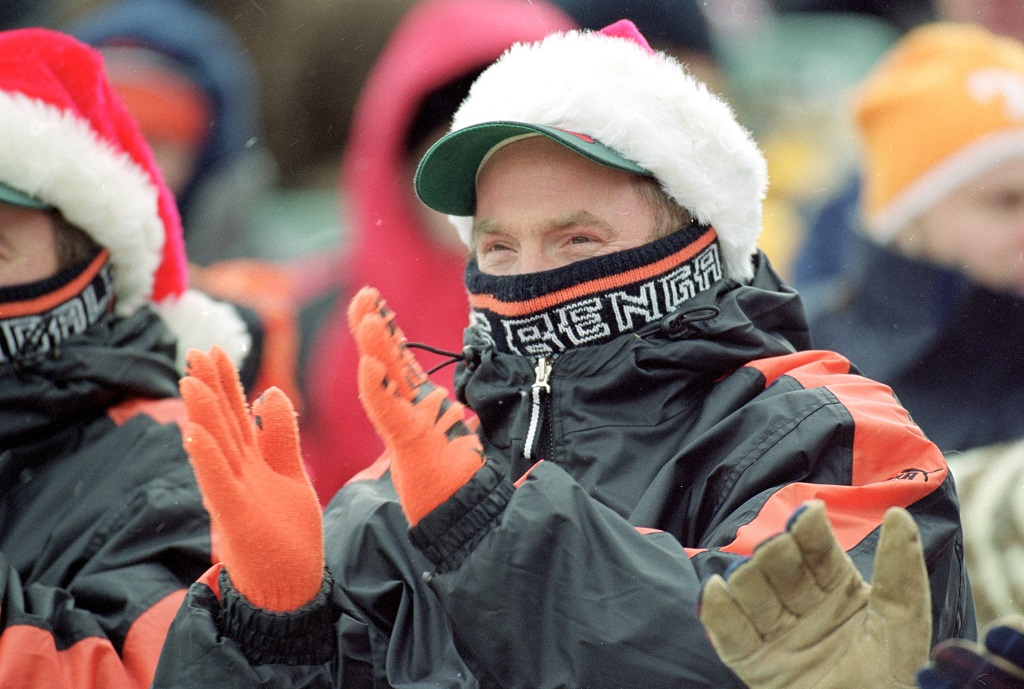 17 Dec 2000: A fan of the Cincinnati Bengals claps as he is covered up in the cold weather during the game against the Jacksonville Jaguars at the Paul Brown Stadium in Cincinnati, Ohio. The Bengals defeated the Jaguars 17-14.
