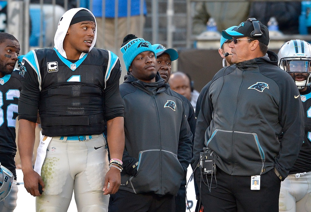 Cam Newton and Ron Rivera chat on the sidelines
