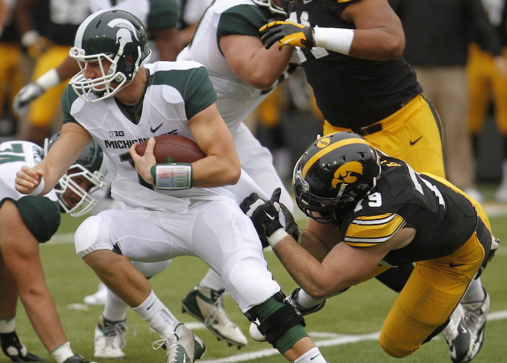 Connor Cook breaks a tackle against Iowa