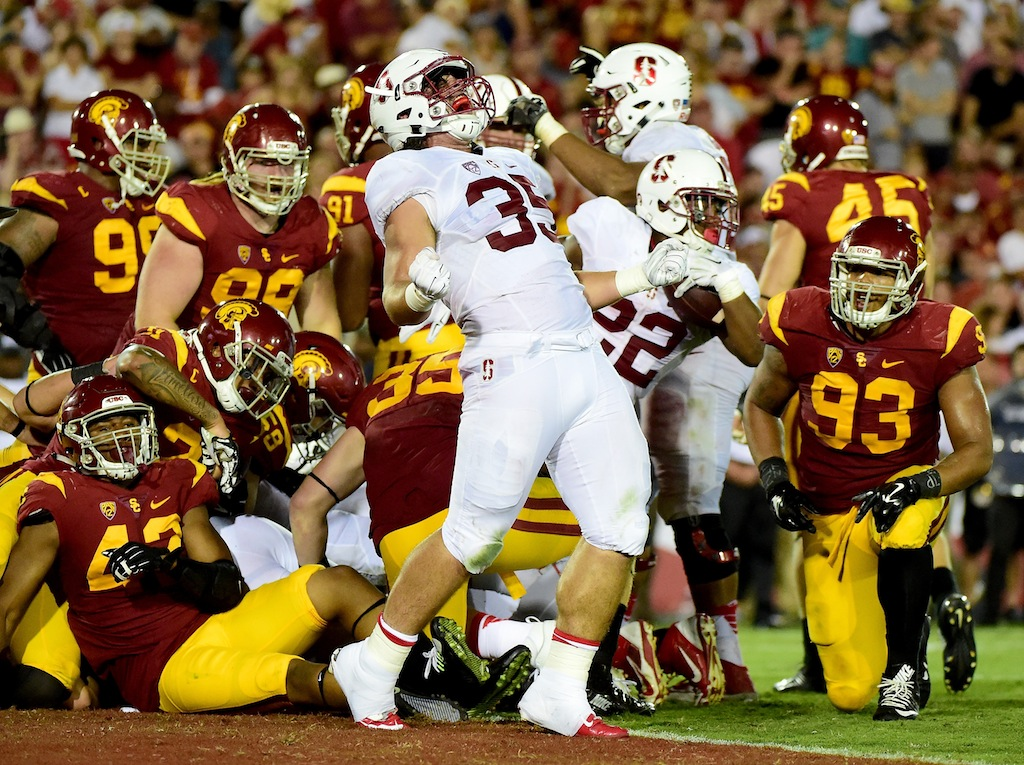 Daniel Marx #35 of the Stanford Cardinal celebrates the touchdown of Remound Wright #22
