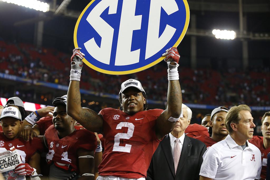 Derrick Henry celebrates after Alabama wins the SEC