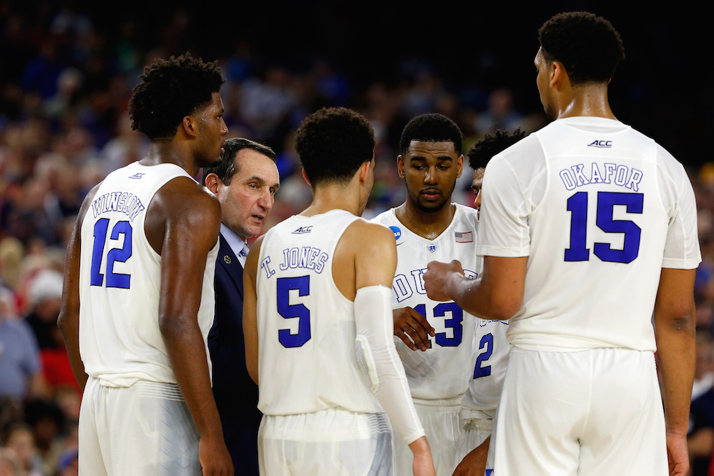 Head coach Mike Krzyzewski of the Duke Blue Devils huddles with his team against the Gonzaga Bulldogs during the South Regional Final of the 2015 NCAA Men's Basketball Tournament