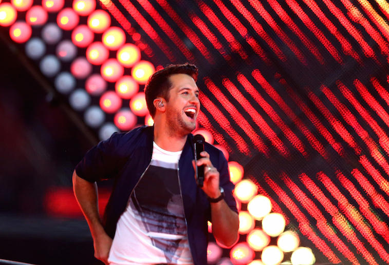 Luke Bryan looks happy as he performs on stage.
