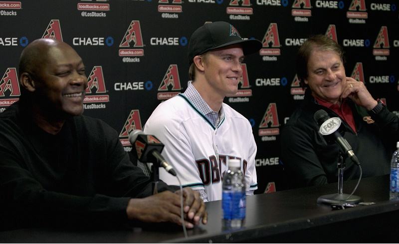 Zack Greinke sits down at a press conference.