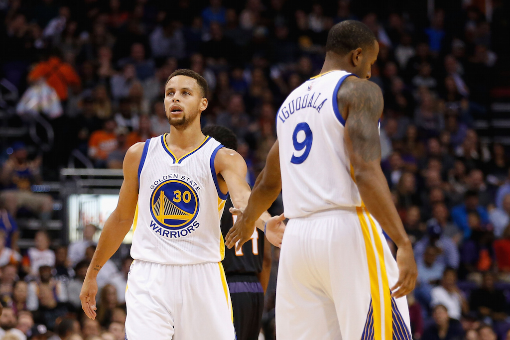 Stephen Curry high fives Andre Iguodala
