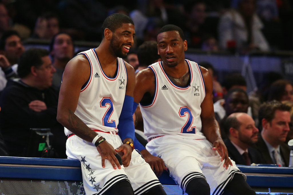Kyrie Irving (L) and John Wall chat during the 2015 NBA All-Star Game