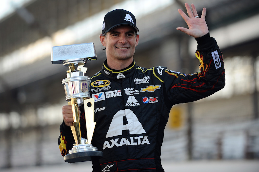 INDIANAPOLIS, IN - JULY 27:  Jeff Gordon, driver of the #24 Axalta Chevrolet, celebrates with the trophy after winning the NASCAR Sprint Cup Series Crown Royal Presents The John Wayne Walding 400 at the Brickyard Indianapolis Motor Speedway on July 27, 2014 in Indianapolis, Indiana.  (Photo by Rainier Ehrhardt/Getty Images)