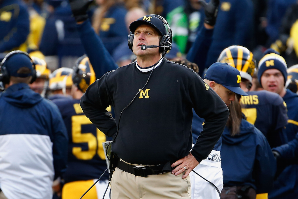 Jim Harbaugh reacts on the sidelines during a game against Michigan State