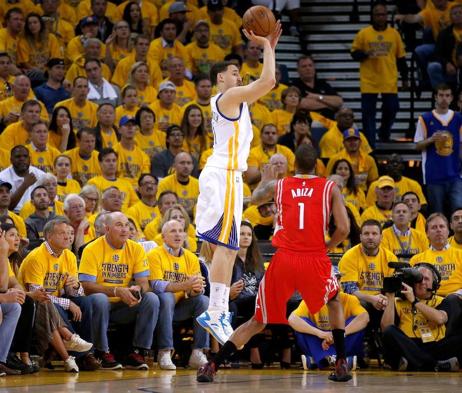 Klay Thompson shoots a three-pointer