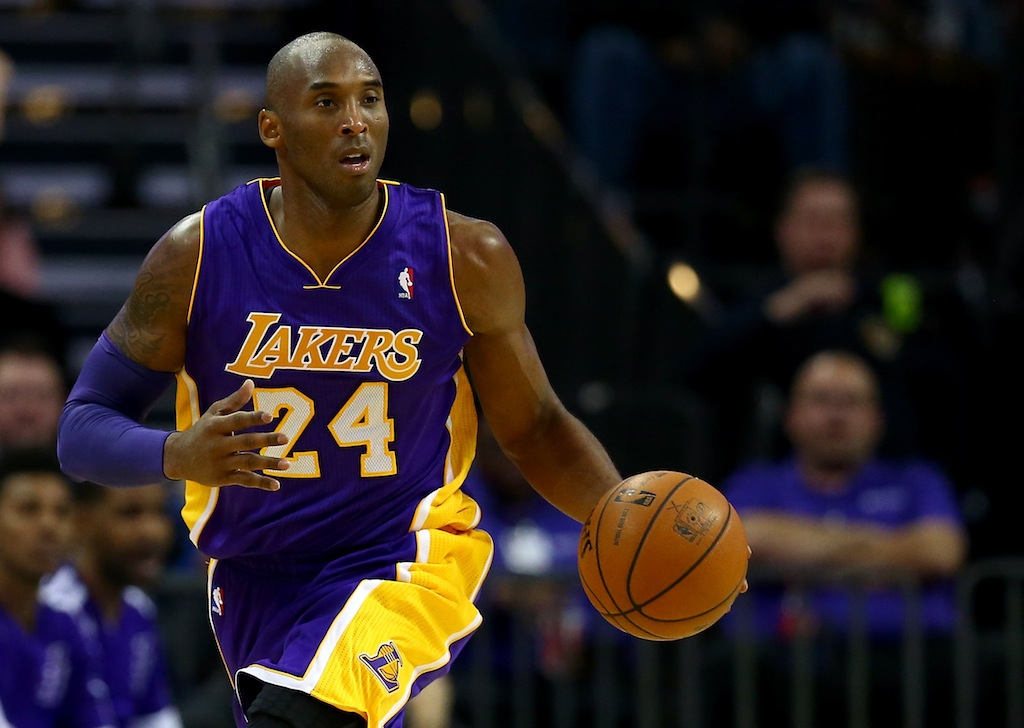 Kobe Bryant dribbles toward the basket.