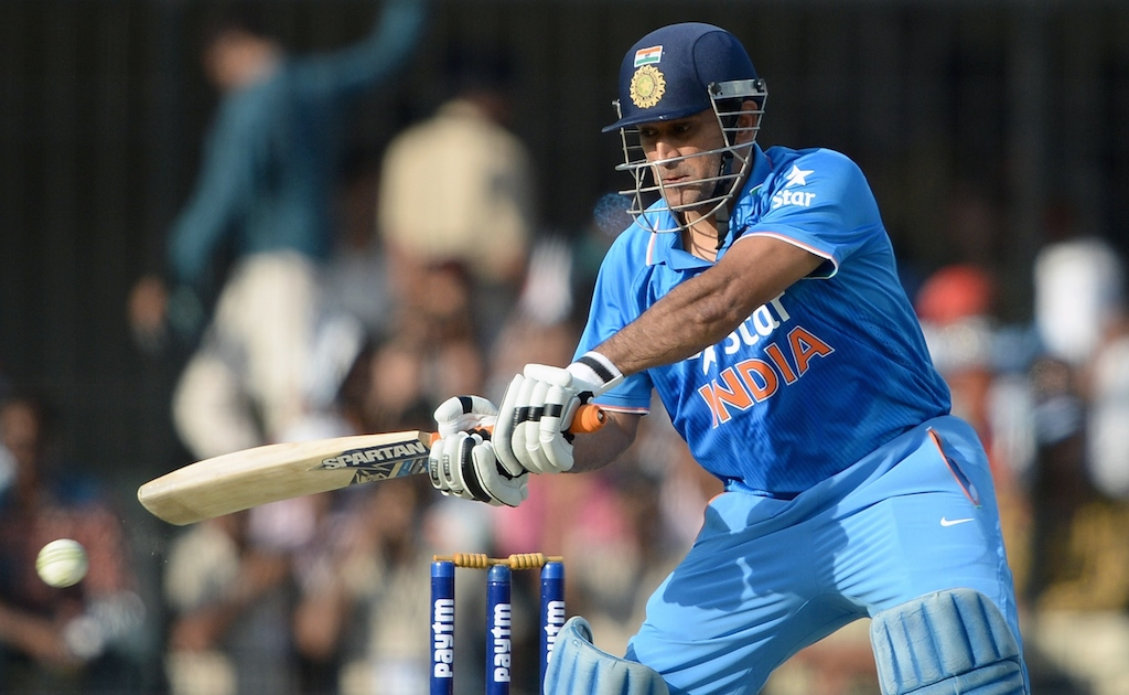India's captain Mahendra Singh Dhoni plays a shot during the second one day international (ODI) cricket match between India and South Africa
