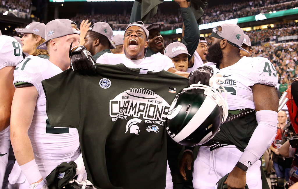 Michigan State players celebrate winning the Big Ten
