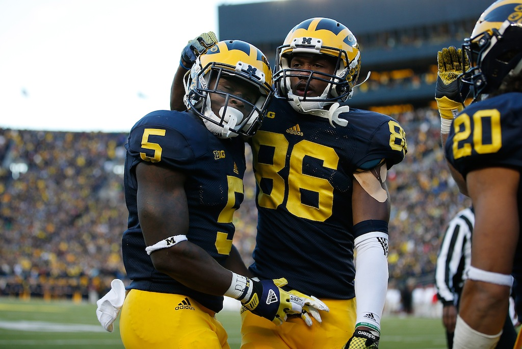 Jabrill Peppers #5 of the Michigan Wolverines celebrates his second quarter touchdown with Jehu Chesson #86