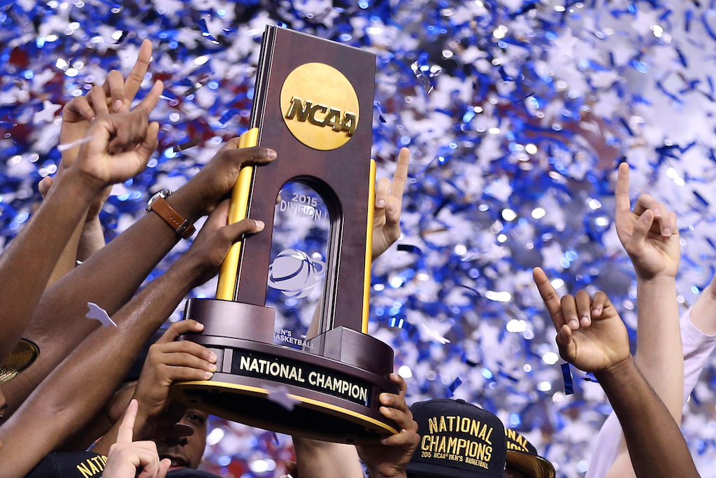 INDIANAPOLIS, IN - APRIL 06: The Duke Blue Devils hold up the championship trophy after defeating the Wisconsin Badgers during the NCAA Men's Final Four National Championship at Lucas Oil Stadium on April 6, 2015 in Indianapolis, Indiana. Duke defeated Wisconsin 68-63.