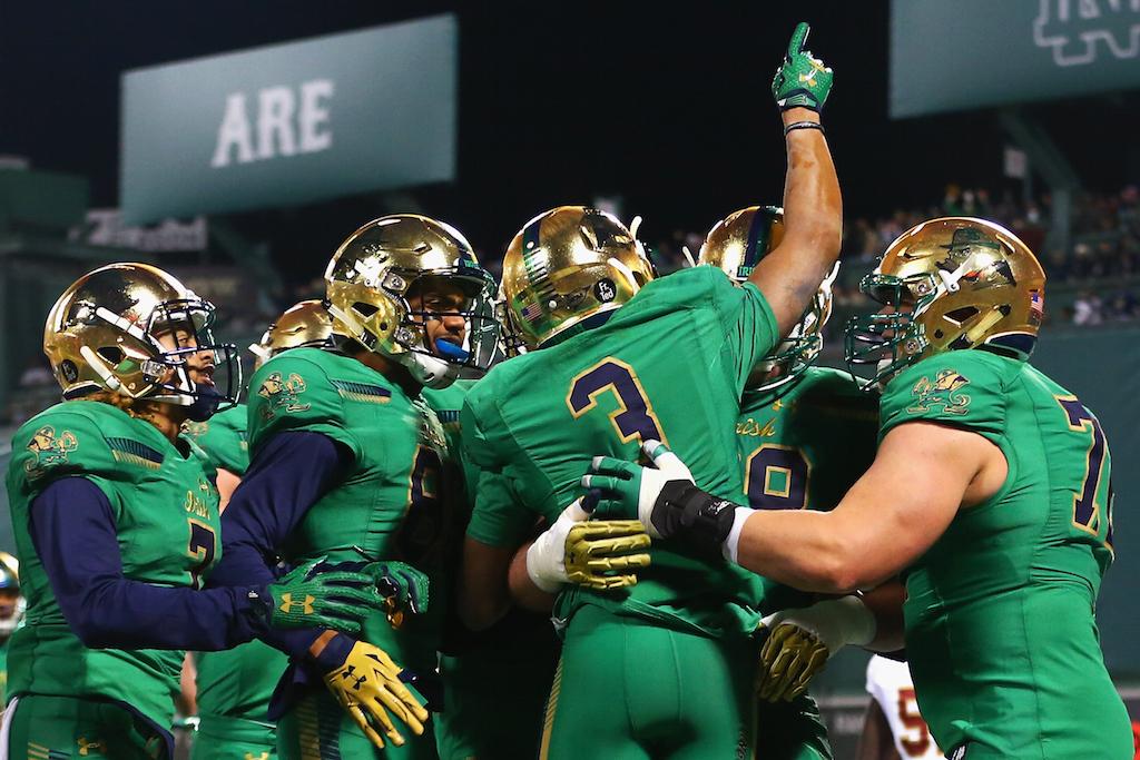 Notre Dame players celebrate a touchdown