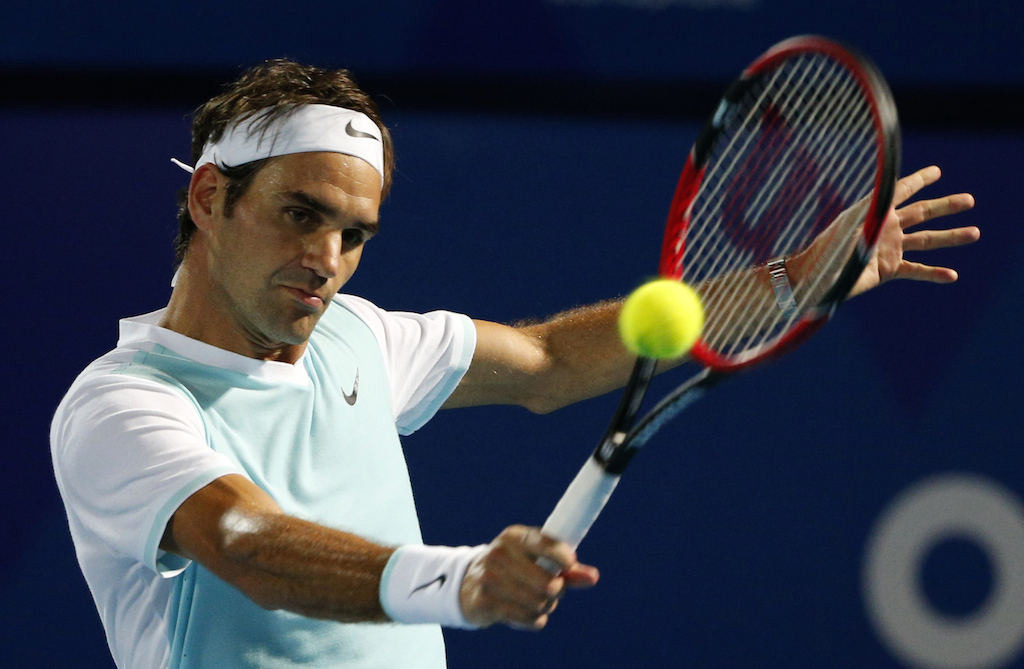Swiss Roger Federer of Obi UAE Royals team hits a return to Briton Andy Murray