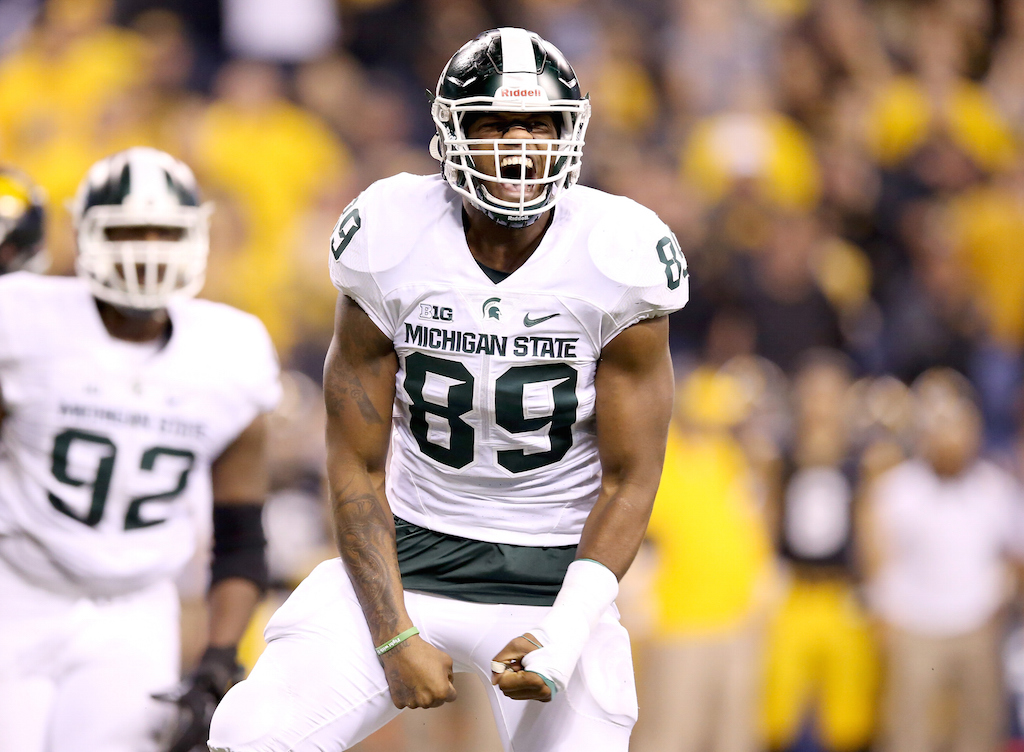 Shilique Calhoun #89 of the Michigan State Spartans celebrates after making a play against Iowa