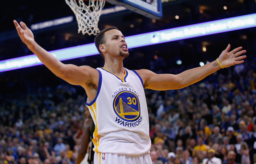 Stephen Curry reacts toward the crowd
