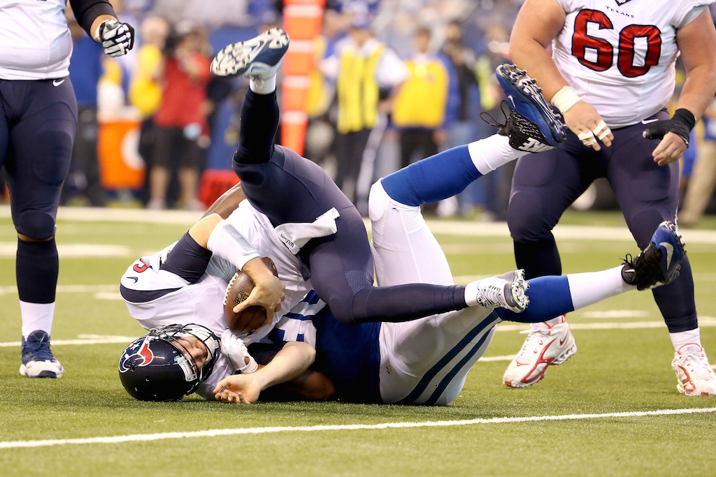 T.J. Yates is sacked during game against the Colts