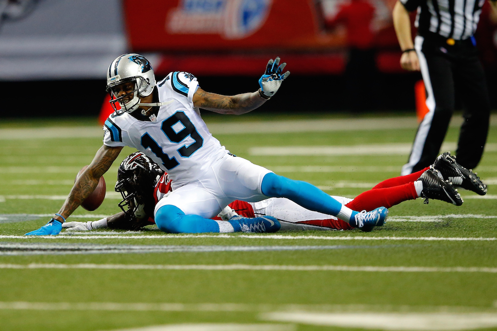 Ted Ginn Jr. tries to make a play against the Falcons