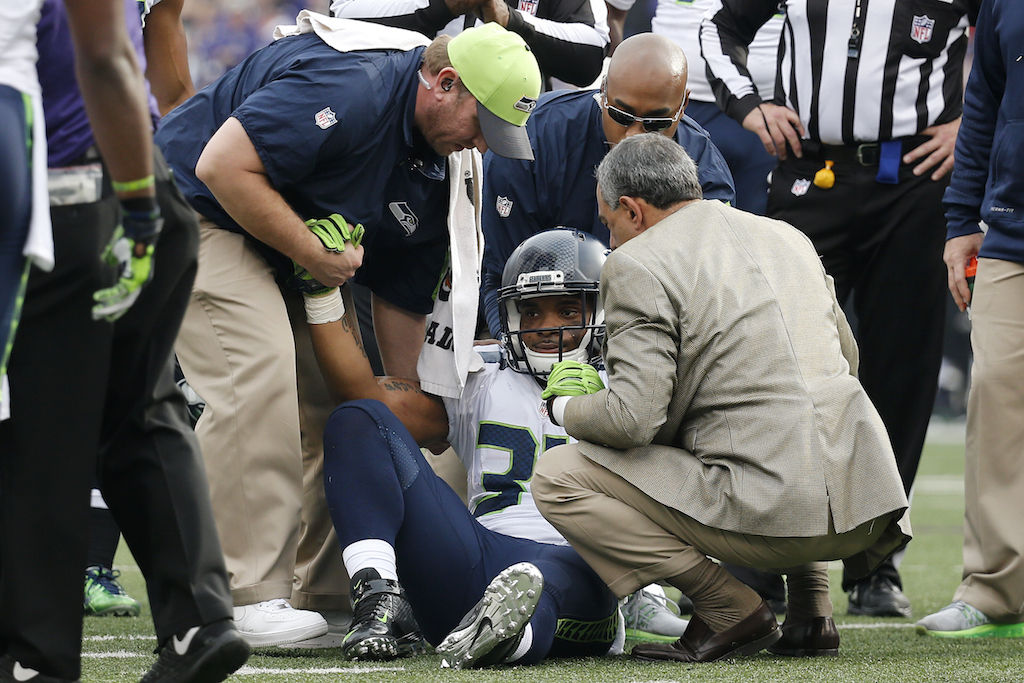 Thomas Rawls is tended to after being injured