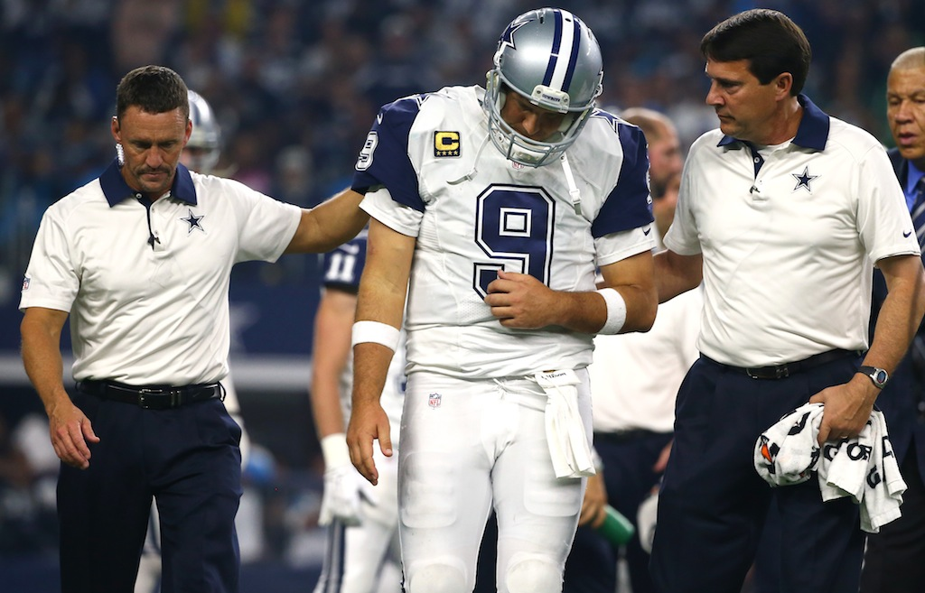 Tony Romo is helped off the field