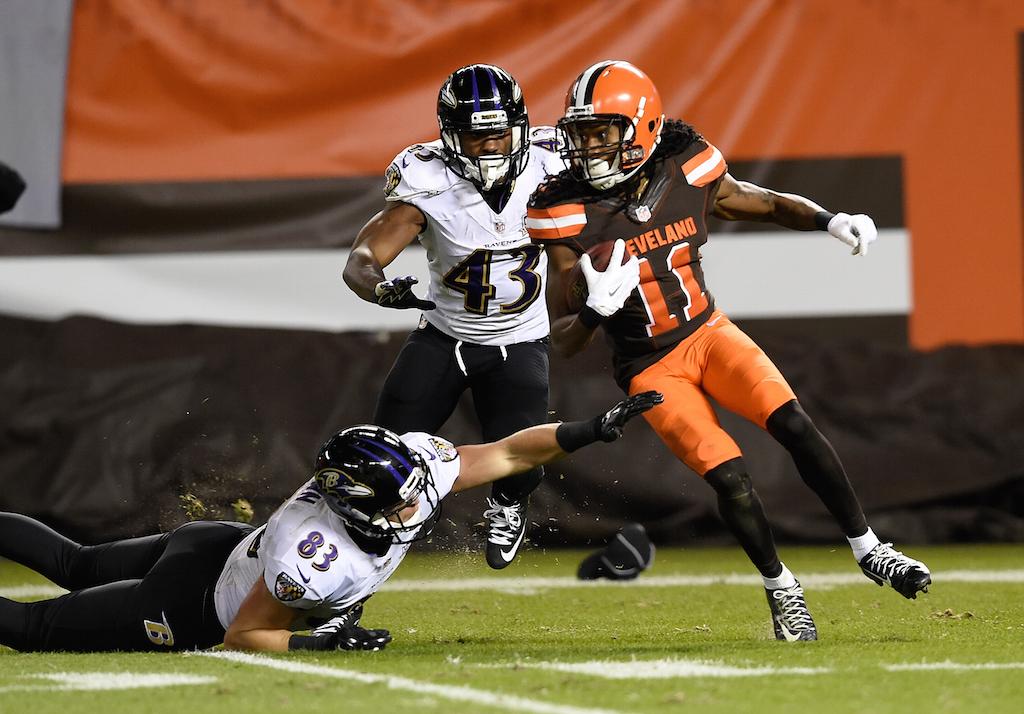 Travis Benjamin avoids Ravens tacklers