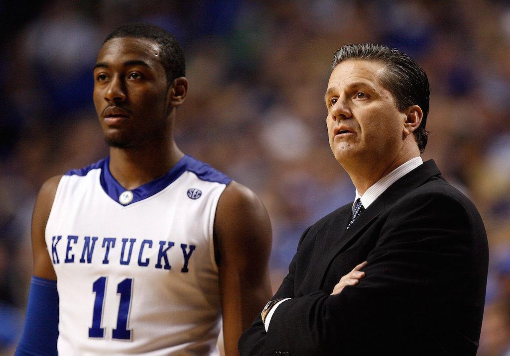 John Wall and John Calipari look on for Kentucky