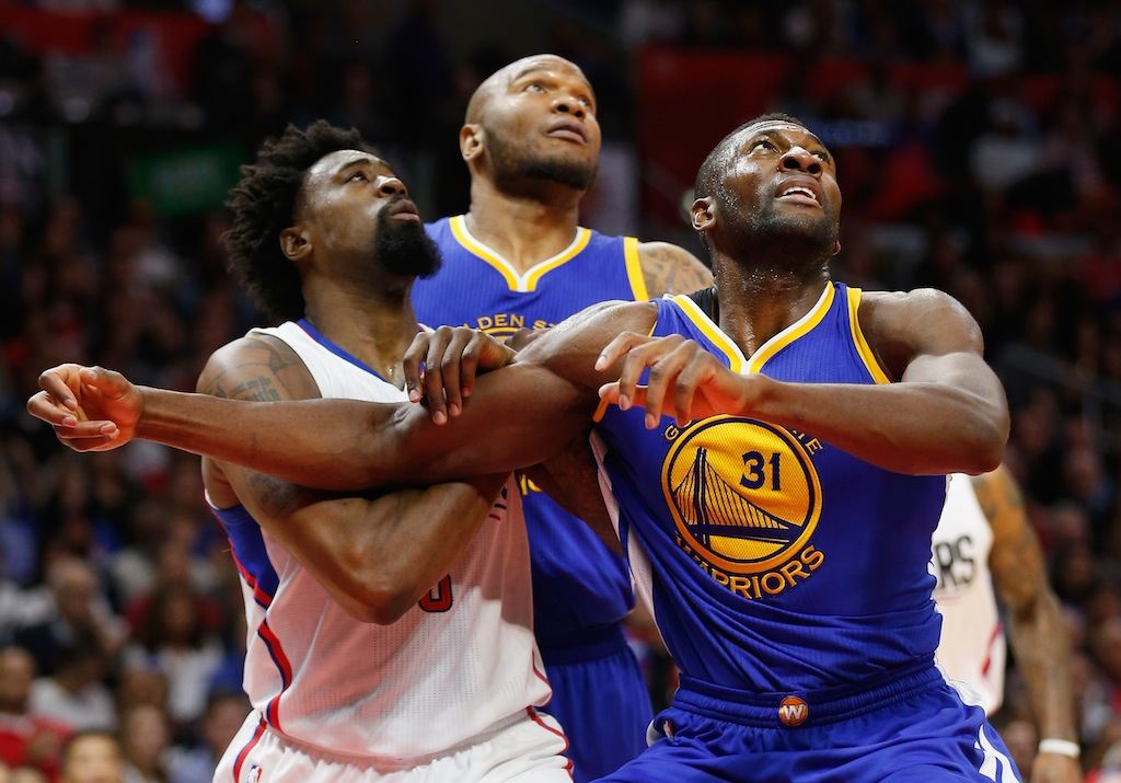 DeAndre Jordan #6 of the Los Angeles Clippers, Marreese Speights #5 of the Golden State Warriors,and Festus Ezeli #31 of the Golden State Warriors battle for position