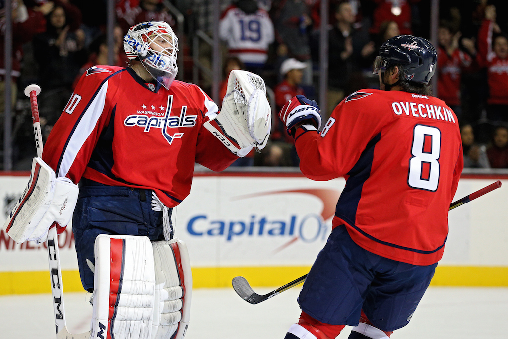 Goalie Braden Holtby #70 of the Washington Capitals and teammate Alex Ovechkin #8 celebrate after defeating the Edmonton Oilers