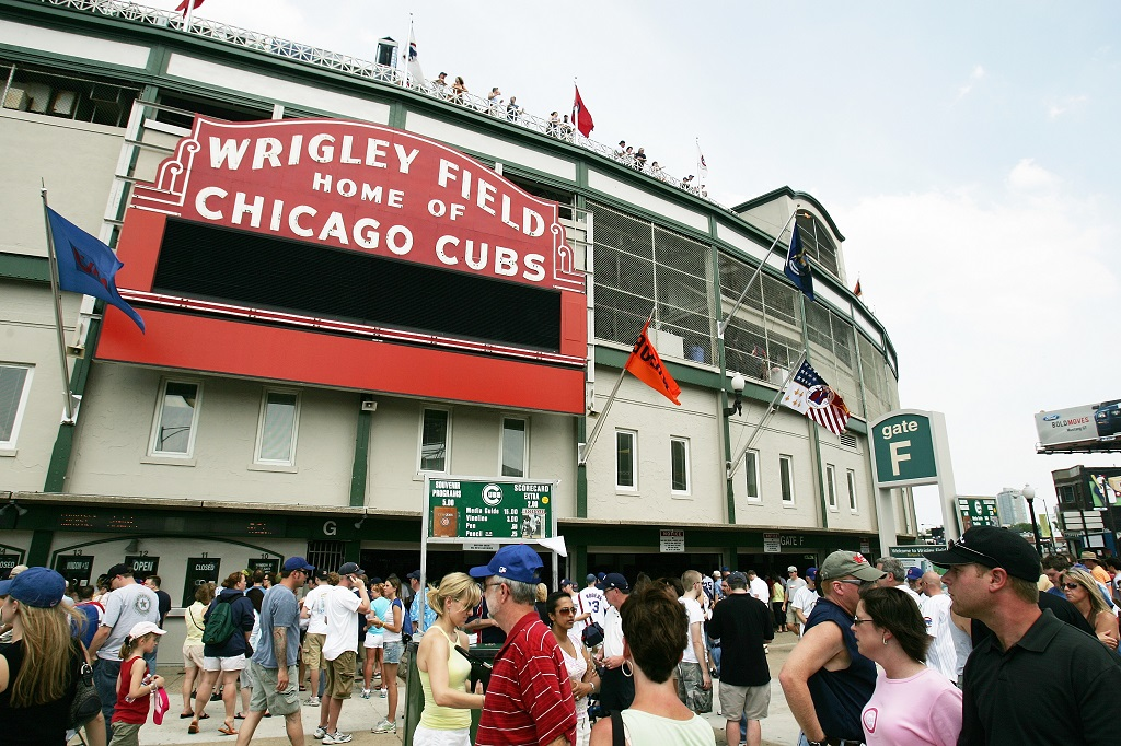CHICAGO - JUNE 17: Fans walk up to Wrigley Field before the Chicago Cubs game against the Detroit Tigers on June 17, 2006 at Wrigley Field in Chicago, Illinois. The Tigers defeated the Cubs 9-3. (Photo by )