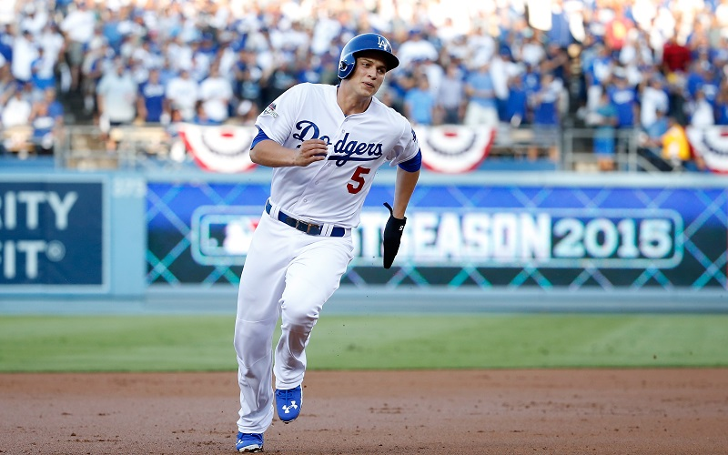 Corey Seager heads toward third base.