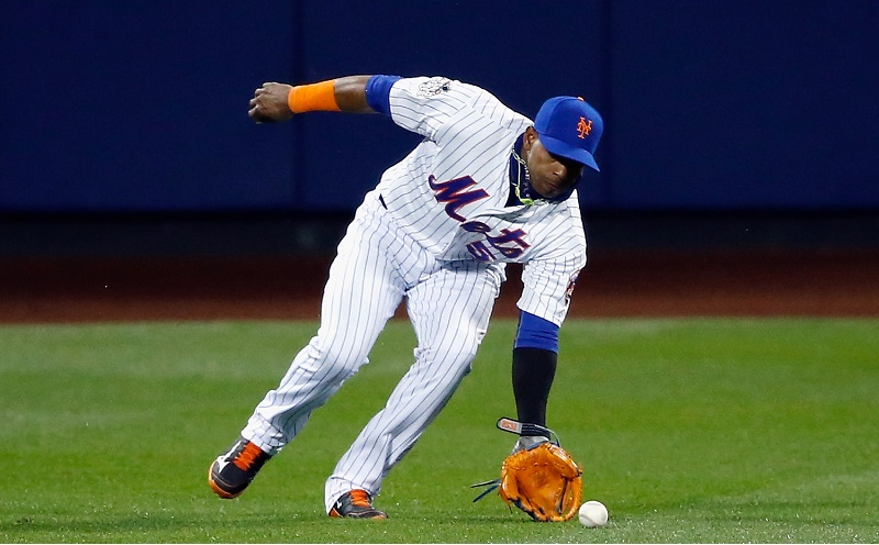 Yoenis Cespedes scoops up the ball in the outfield.