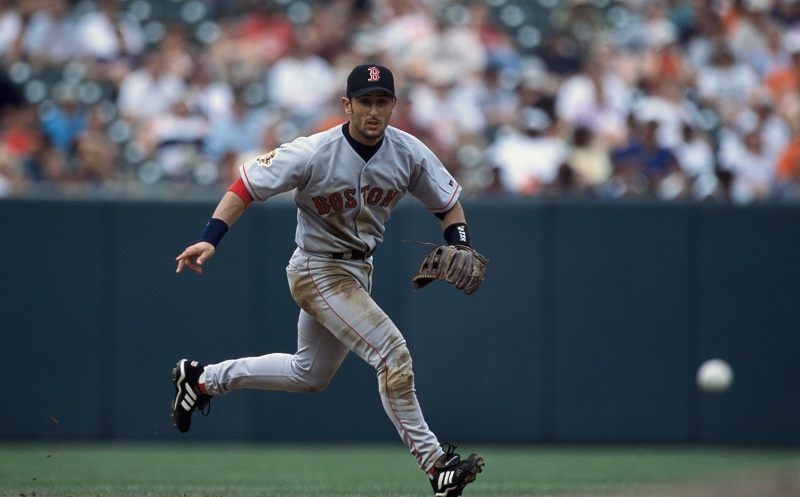 Infielder Nomar Garciaparra #5 of the Boston Red Sox running after the ground ball | Doug Pensinger /Allsport