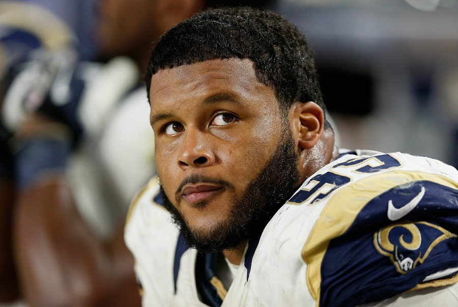 Los Angeles Rams defensive tackle Aaron Donald takes a break during a game.