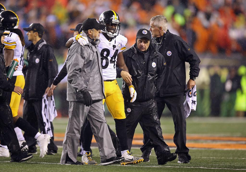 Antonio Brown is helped off the field