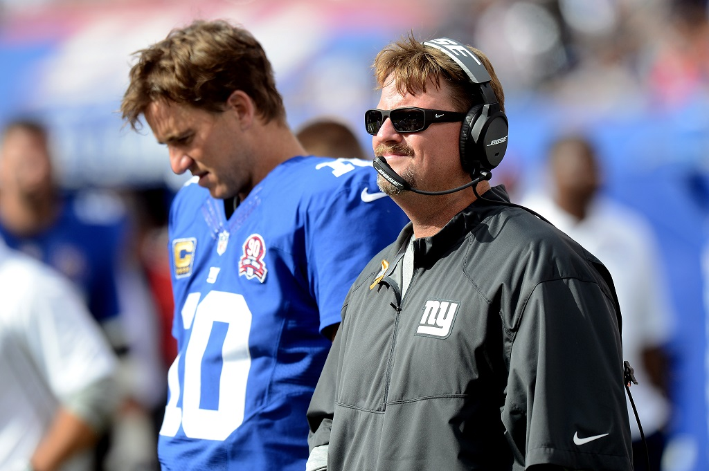 EAST RUTHERFORD, NJ - SEPTEMBER 14:  Offensive coordinator Ben McAdoo and quarterback Eli Manning #10 of the New York Giants look on from the sideline against the Arizona Cardinals during a game at MetLife Stadium on September 14, 2014 in East Rutherford, New Jersey.