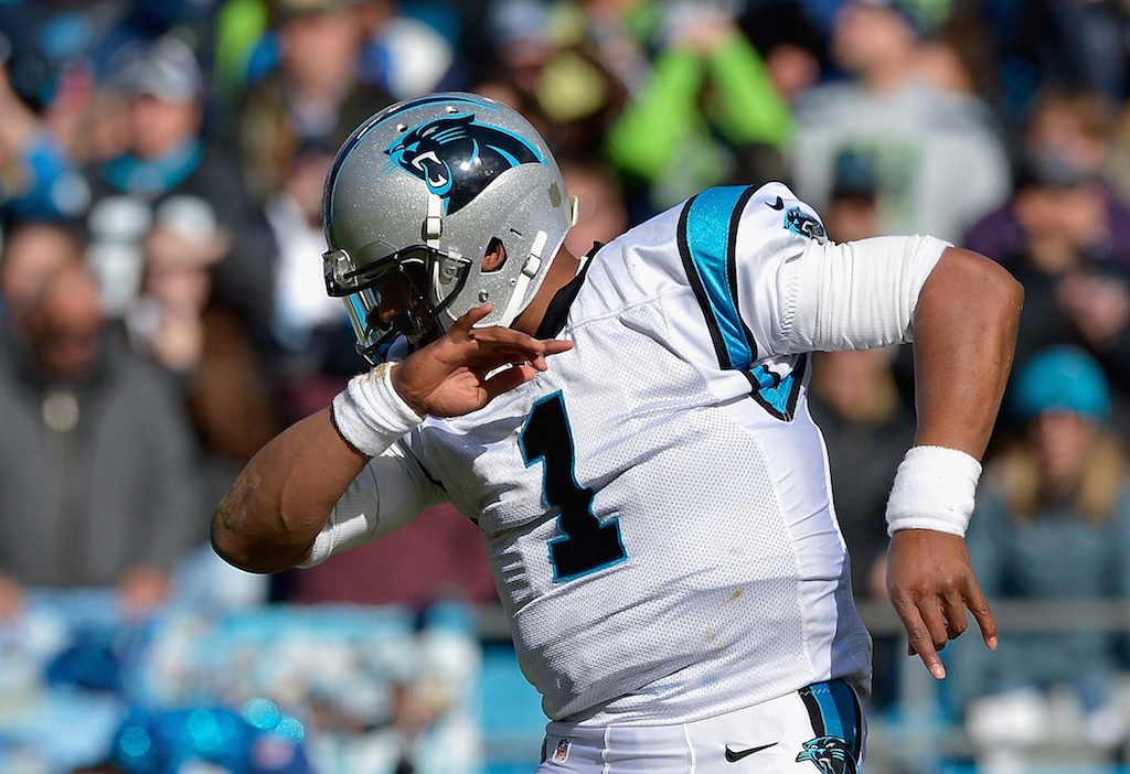 Cam Newton #1 of the Carolina Panthers shows his trademark 'dab' against the Seattle Seahawks