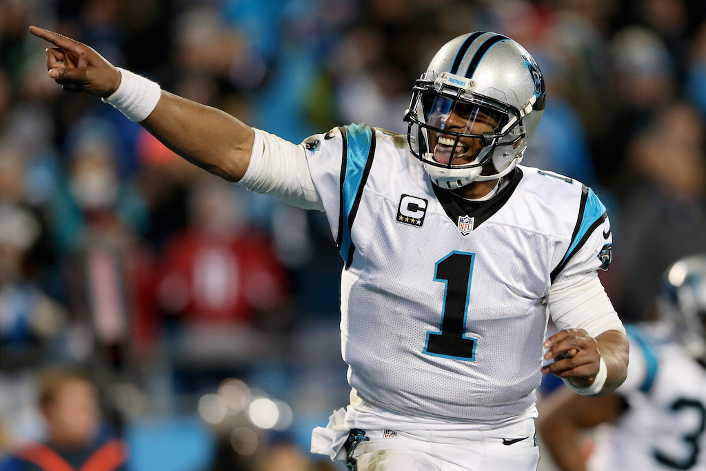 Cam Newton celebrates during the NFC Championship game