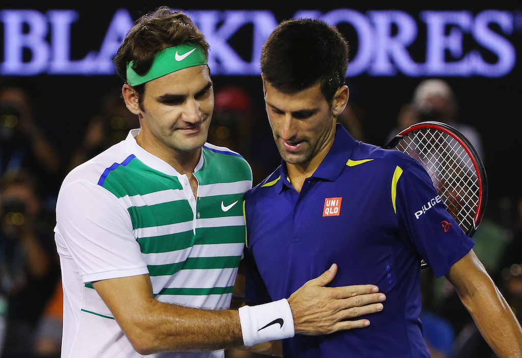 Novak Djokovic of Serbia is congratulated after winning in his semi final match against Roger Federer (L)