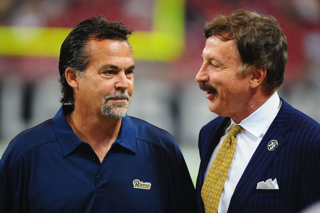 Stan Kroenke (R) speaks with former Los Angeles Rams head coach Jeff Fisher.