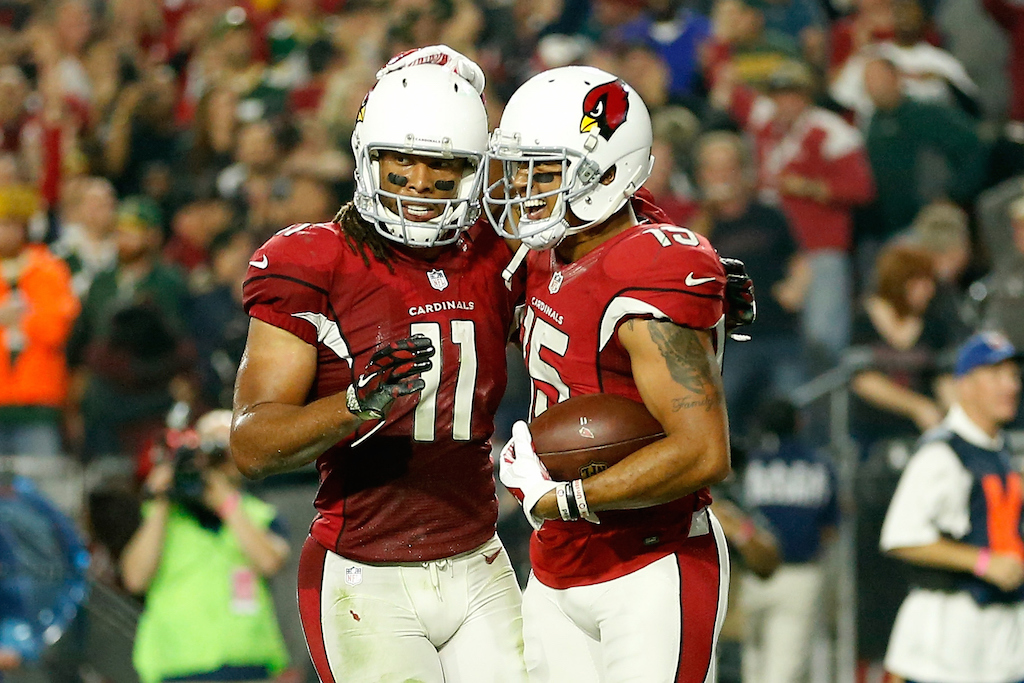 Wide receiver Michael Floyd #15 of the Arizona Cardinals celebrates touchdown catch with wide receiver Larry Fitzgerald #11 in the NFC Divisional Playoff Game