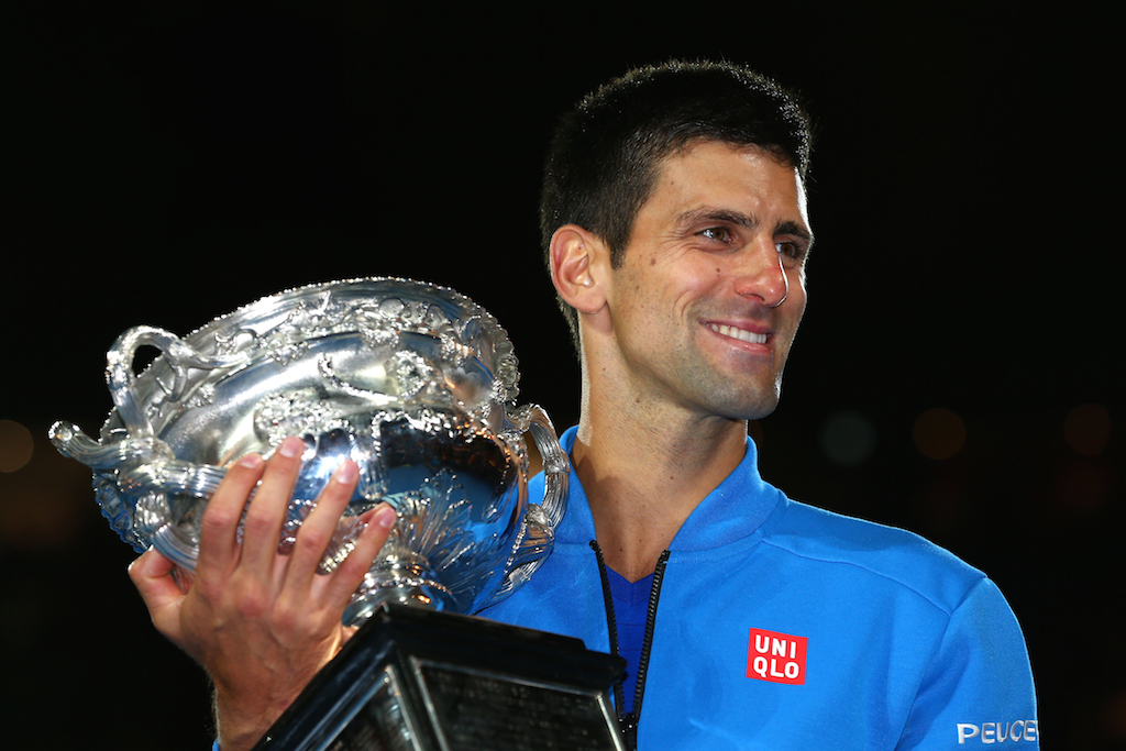 Novak Djokovic of Serbia holds the Norman Brookes Challenge Cup after winning his men's final match